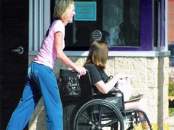 pushing-wheelchair-while-pregnant