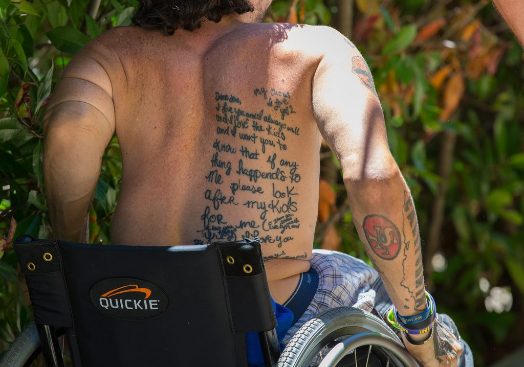 wheelchair userhas back tattoo