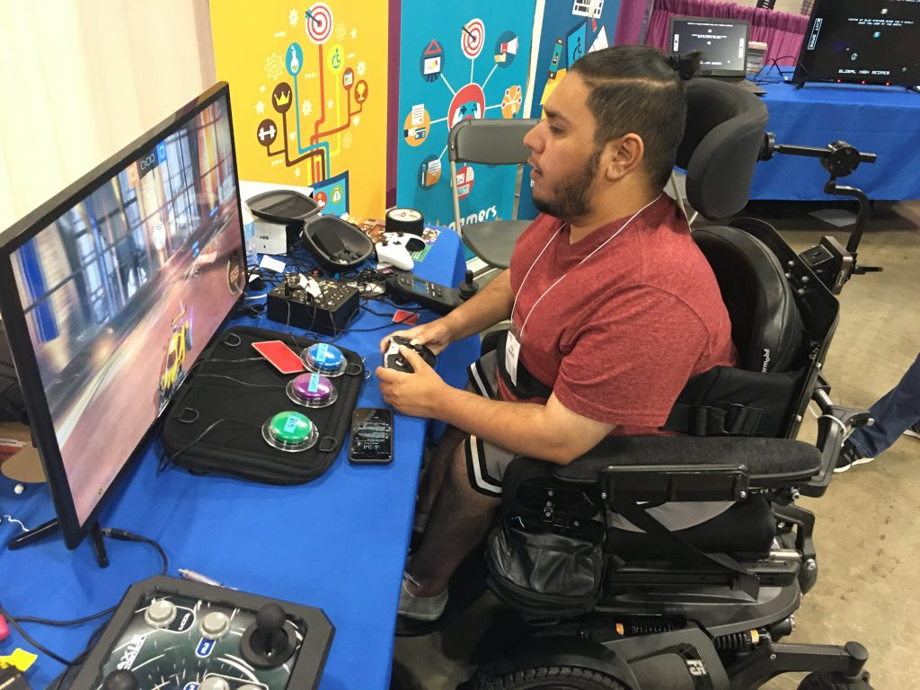 Man in a wheelchair is playing video games