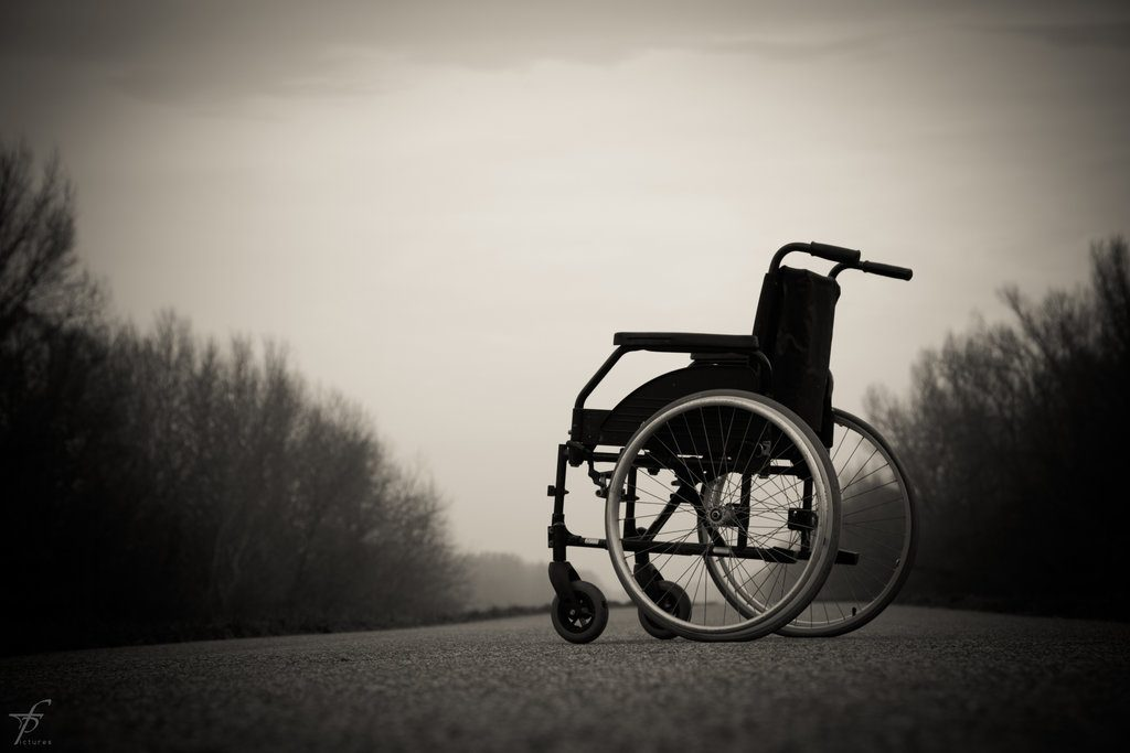lonely wheelchair on the road